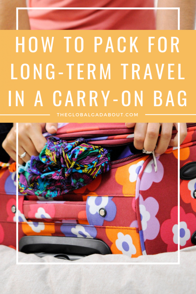 I travel for long periods of time and I hate checking a bag. Over years of practice, I've gotten packing for 6 months in a carry-on suitcase down to a science! Click to find out how I do it and get tips for packing more in less space. #travel #travelblog #theglobalgadabout #traveltips #packingtips #packinglist