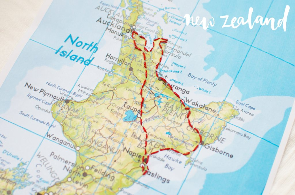 A map of the north island of New Zealand wth a route stitched into the map with red thread.