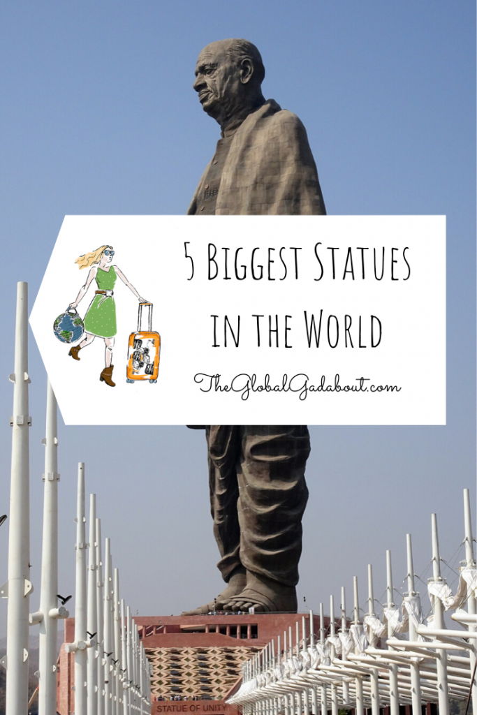 """The Statue of Unity looking up from the ground with a blue sky behind. A luggage tag shape in white covers the middle of the statue with The Global Gadabout logo and the words """"5 Biggest Statues in the World"""" and """"TheGlobalGadabout.com""""."""