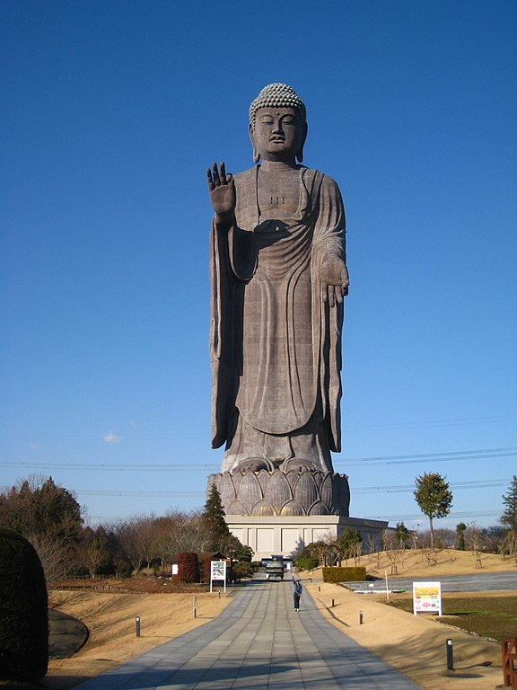 The bronze Ushiku Daibutsu statue, including the lotus platform and the road leading up to the statue.