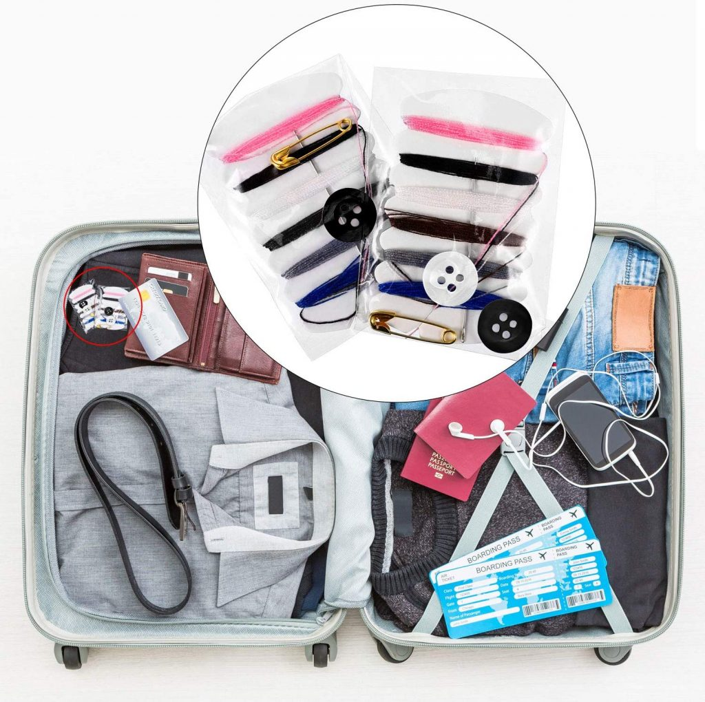 An open, packed suitcase with a close up of two mini sewing kits.