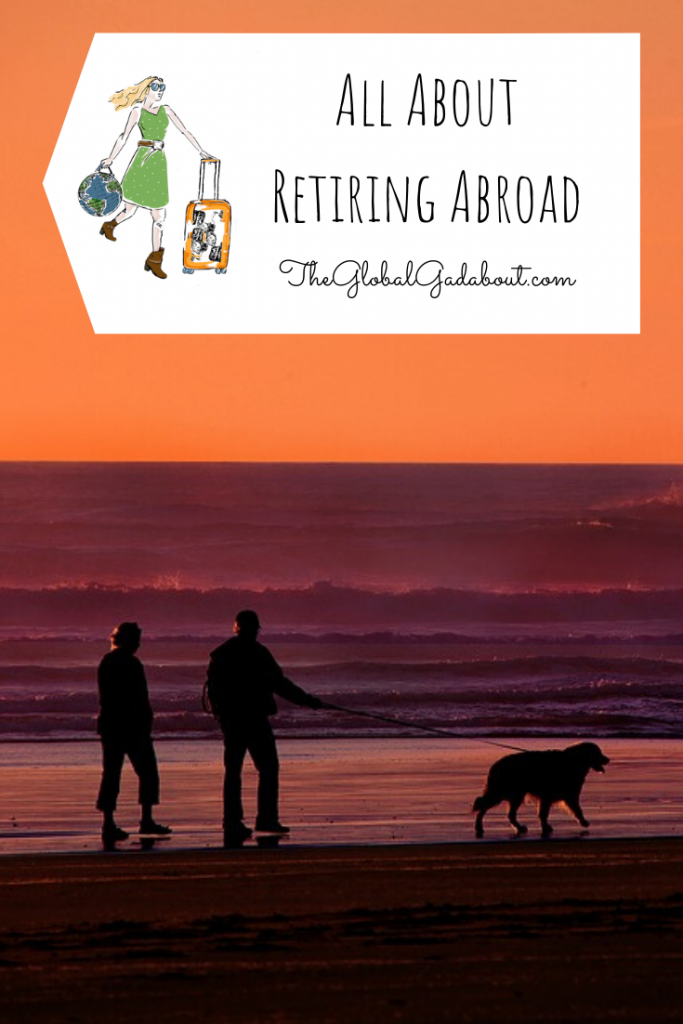 "An older couple walking a dog along a beach at sunset. A white luggage-tag shape in the top third with The Global Gadabout logo and the words ""All About Retiring Abroad"" and ""TheGlobalGadabout.com""."