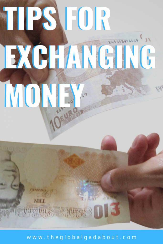 "Two hands exchanging money - a 10 euro bill on top & a 10 pound note on the bottom. White words with blue shadow over the top half reading ""Tips for Exchanging Money"". A narrow blue box across the bottom with the words ""www.TheGlobalGadabout.com"" in white."