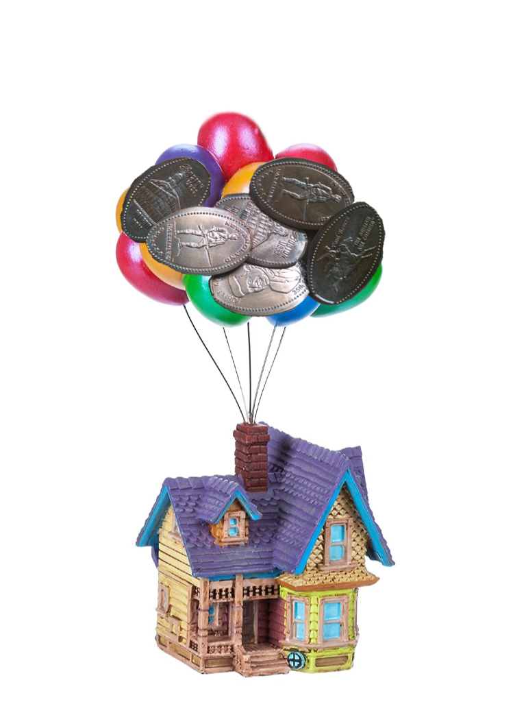 A yellow Victorian house with balloons coming out of the chimney and souvenir pressed pennies over the balloons.