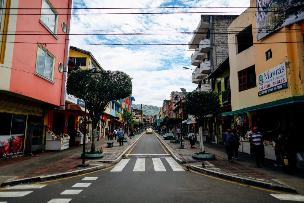 City street in Ecuador with colorful buildings.