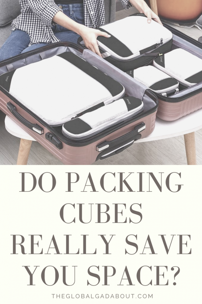 "Open suitcase full of packing cubes. Hands are placing the last packing cube into the suitcase. Underneath are the words ""Do Packing Cubes Really Save You Space? TheGlobalGadabout.com""."