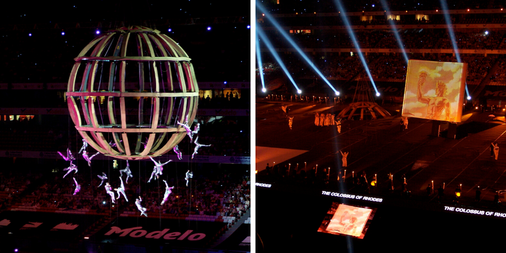 Two scenes from the unveiling ceremony of the New 7 Wonders of the World. The left shows an enormous globe with acrobatic performers suspended from it, the right shows a giant book with the Colossus of Rhodes on it, performers, and spotlights.