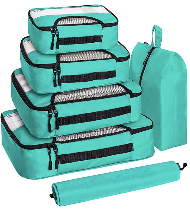 A set of different sized teal packing cubes.
