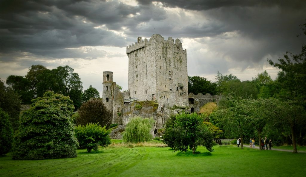 Blarney Castle in Ireland with dark clouds in the sky.
