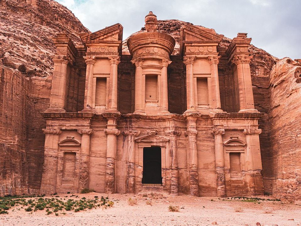 A pink stone building carved from a cliffside at Petra in Jordan.