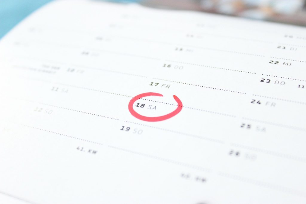A calendar page with the 18th circled in red.