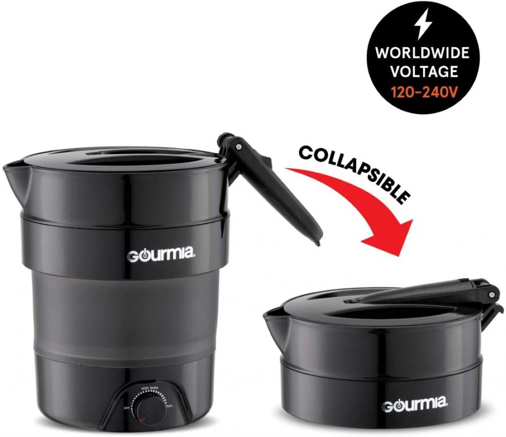 "Travel kettle in collapsed and fully open sizes. ""Worldwide Voltage: 120-240v"" is written in a black circle in the top right."