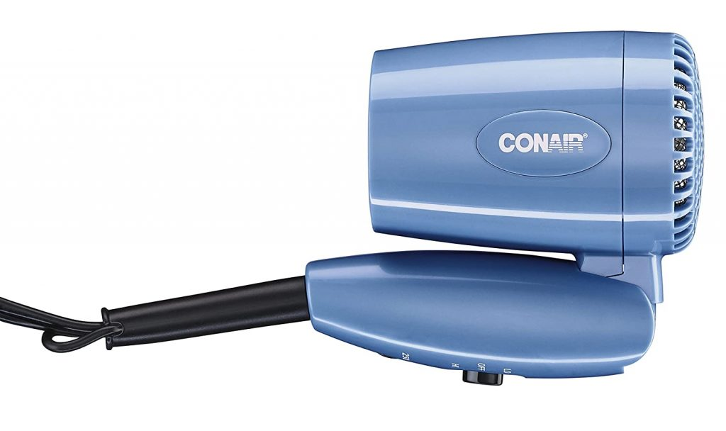 A blue Conair travel hair dryer, folded in half for packing.