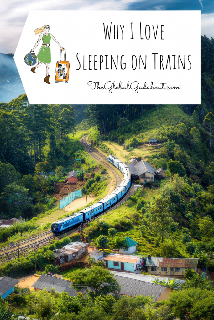 "Train curving through a mountainous region with a few buildings beside the tracks. A white luggage-tag shape overs the top with The Global Gadabout logo and the words ""Why I Love Sleeping on Trains"" and ""TheGlobalGadabout.com""."