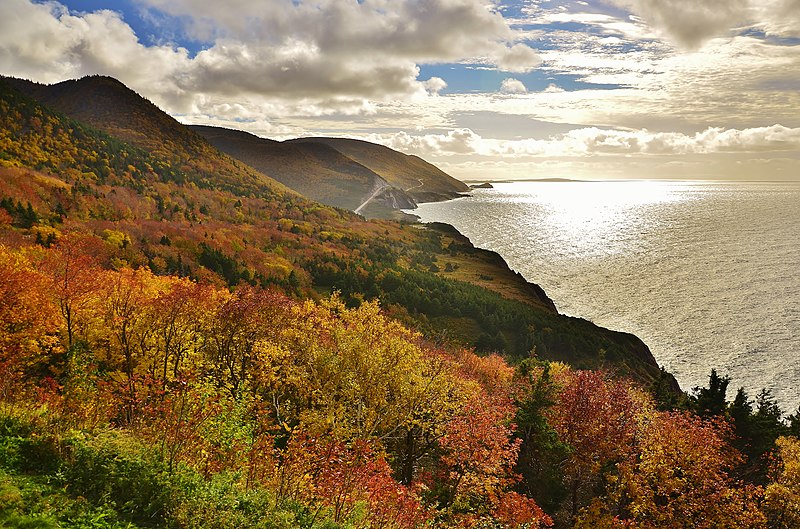 The Cabot Trail coastal road in Nova Scotia, Canada in autumn with fall foliage colors.