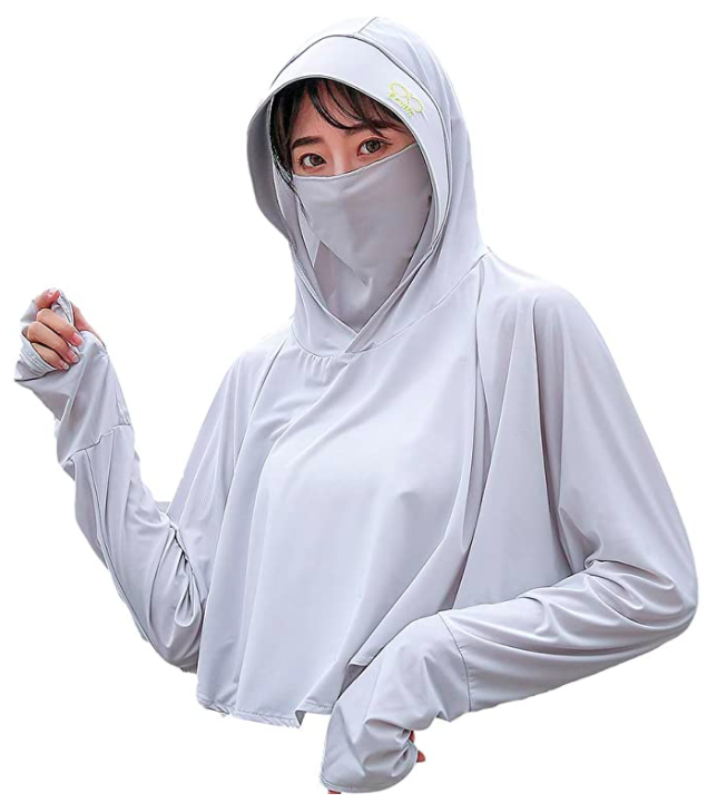 A woman in a hooded top with a mask.