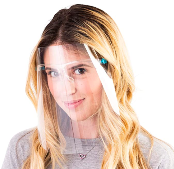 A blond woman wearing a face shield.