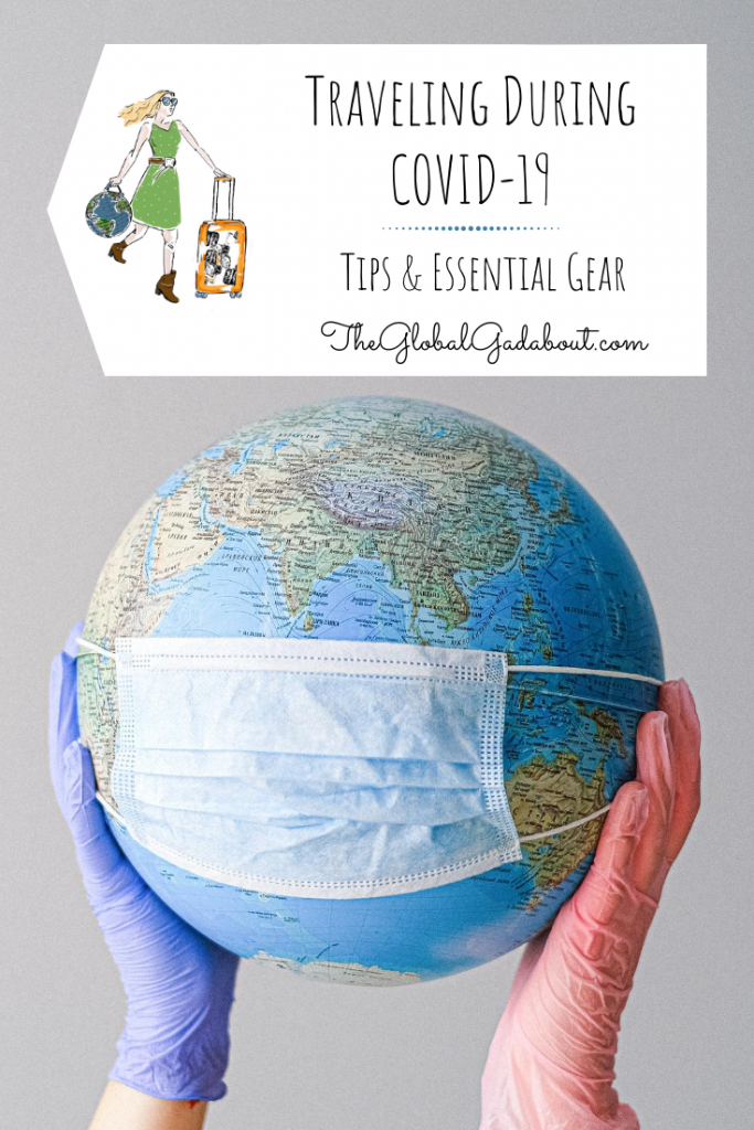 """Gloved hands holding a globe with a disposable face mask. A white luggage tag shape above has The Global Gadabout logo on it and the words """"Traveling During COVID-19: Tips & Essential Gear"""" and """"TheGlobalGadabout.com"""""""